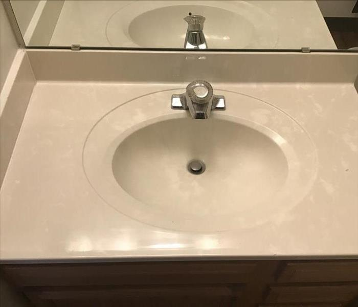 Clean sink and counter top after soot damage.