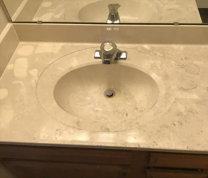 Sink and counter top covered in soot.