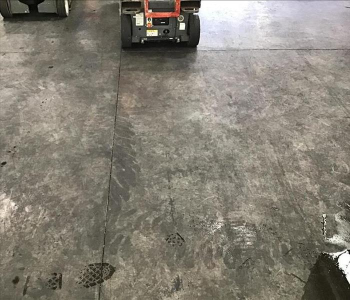 Soot covered concrete floor