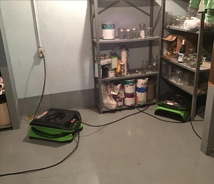 Clean laundry room floor in a residential basement after a sewer backup.